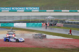 SEPANG, MALAYSIA - JUNE 21: Three race cars crash out into the gravel trap of turn 15 in the rain during the Autobacs (Japan) Su