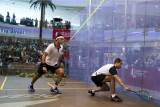 Mens final: Tarek Momen upset Mohamed El Shorbagy in a tensely fought match.