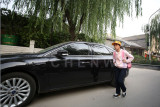 Luxury car is common in Beijing, even in the hutong area