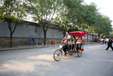 Visitors take a trishaw ride