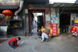Kids playing outside their hutong homes, Beijing