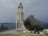 Sherri and bell tower. Telendos behind. Kalymnos, Greece.