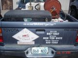 Take a close look at the name of the pest company...Varmit Getter