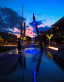 The Oslo Harbor. Coloured fountains and the night's sun over the North Pole