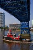 Big Red Tug under the Main Street Bridge