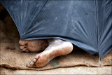 Sleeping under an umbrella