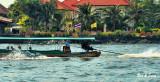 longtail boat speeding down the Chao Phraya River