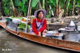 vendor in purple hat