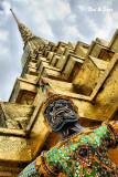 Ramakien figure and golden chedi