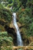monks at top of  Khouang Si Waterfall