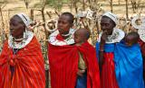 Masai women in traditional costumes with children