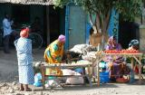 women selling vegetables at street market
