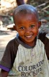smiling boy in Colorado Rockies shirt