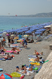 Nice's Rocky And Crowded Beach--Two Images