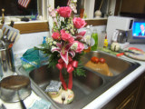Roses and Lilies in kitchen sink
