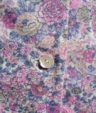 Detail of fabric and button