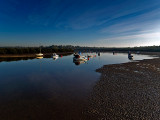 Moored at low tide by Dennis