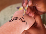 Painting with henna by Geophoto