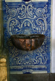 Interior holy water urn and tile background