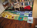 My second queen-size quilt, in pieces on the den floor.