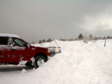 Pushing snowover the 8-foot deer fence