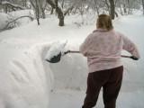 Sue shovelingthe front walkway
