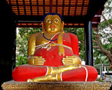 Image of Happy Buddha in red robe