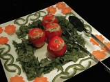 Stuffed tomatoes with carrot and green pepper decoration