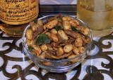 Snack of dried fish and spicy nuts with Mekong whiskey