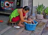 Woman washing baby