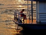 Novice monk on ferry boat