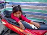 Little girl on motorbike