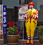 Ronald McDonald greets with a wai
