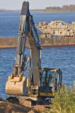 Excavator working on shoreline stabilization