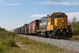 Twice weekly freight train approaching Moosonee