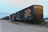 Boxcars along Revillon Road, these are beside the barge docks.