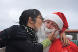 Santa gets a kiss from Lisa