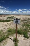 Warning Sign, Badlands National Park, South Dakota