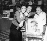 Elvis, Dewey Phillips and Joe Cuoghi at Pop Tunes