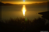 The sun rises on the horizon over San Luis Reservoir