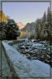 The Merced River is low, but the rocks are covered with snow