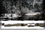 Stoneman Bridge covered with snow and the Merced River