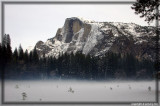 Half Dome with mist rising from the snow covered meadow in the foreground