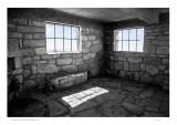 Deserted stone hut interior