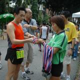 Handing out finisher's medal