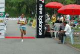 First lady runner to cross the finish line