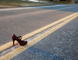 Red Shoe In Road