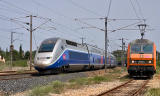 A TGV Duplex is overtaking the BB26200 with a freight train at Les Arcs-Draguignan.