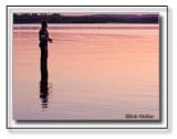 A Fisherman At Dusk