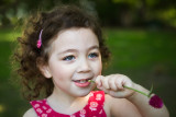 Kayla with a flower